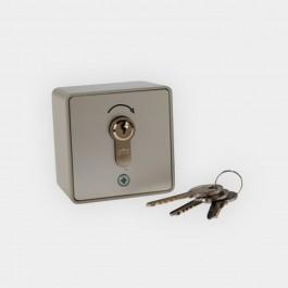 Contacteur à impulsion à clé en applique